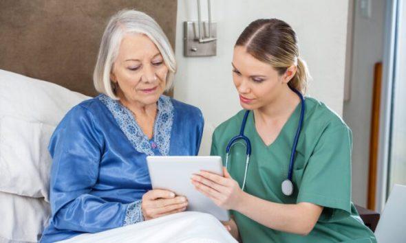 nurse-and-resident-talking-700x420-1-590x354
