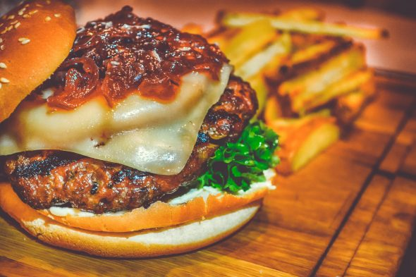 selective-focus-of-ham-burger-on-wooden-surface-photo-750075-590x393